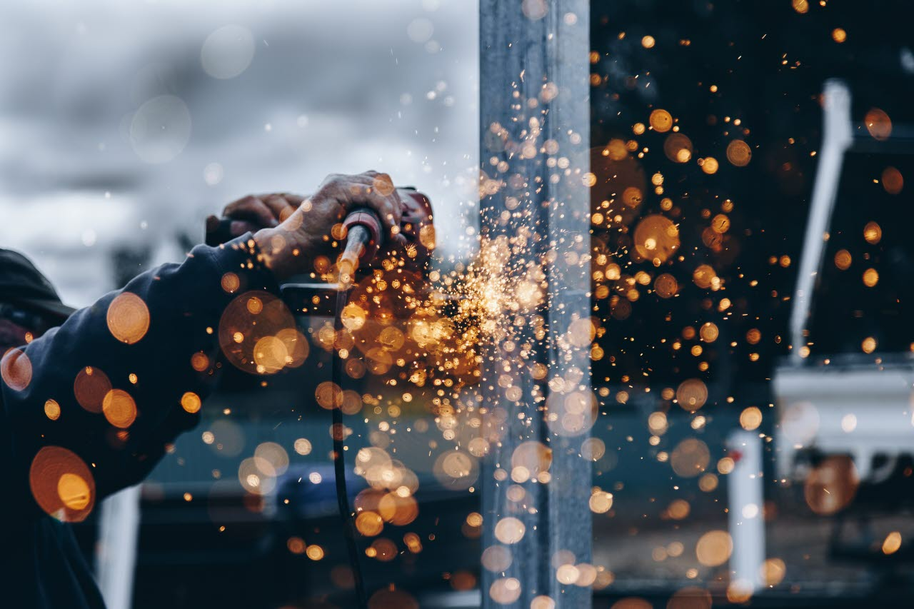 Construction worker with sparks