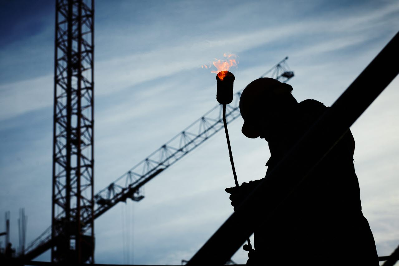 Worker with fire torch