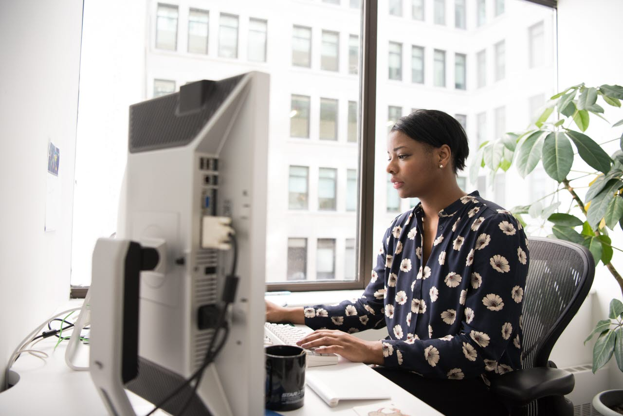 Woman working hard at her desk in the office