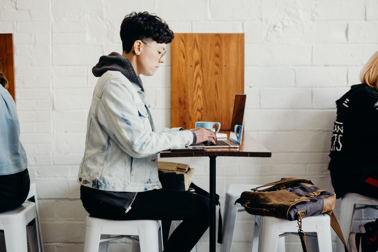 Person working remotely from a cafe
