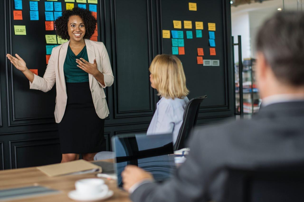 Woman running business meeting