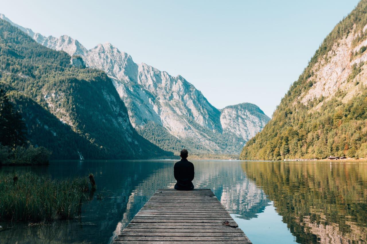Man by alpine lake