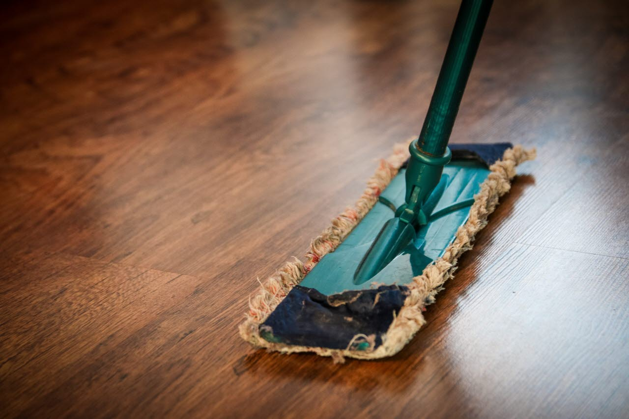 Cleaning a brown wooden floor