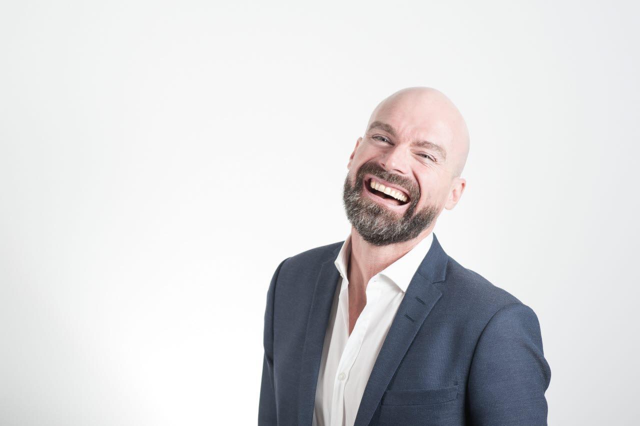 Business Plus man laughing