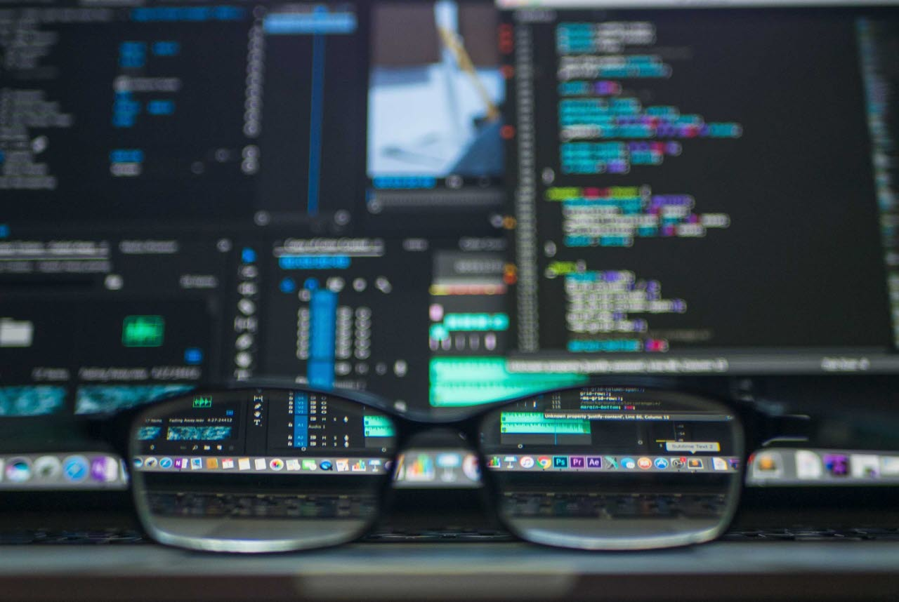 Image of data screen with glasses on desk
