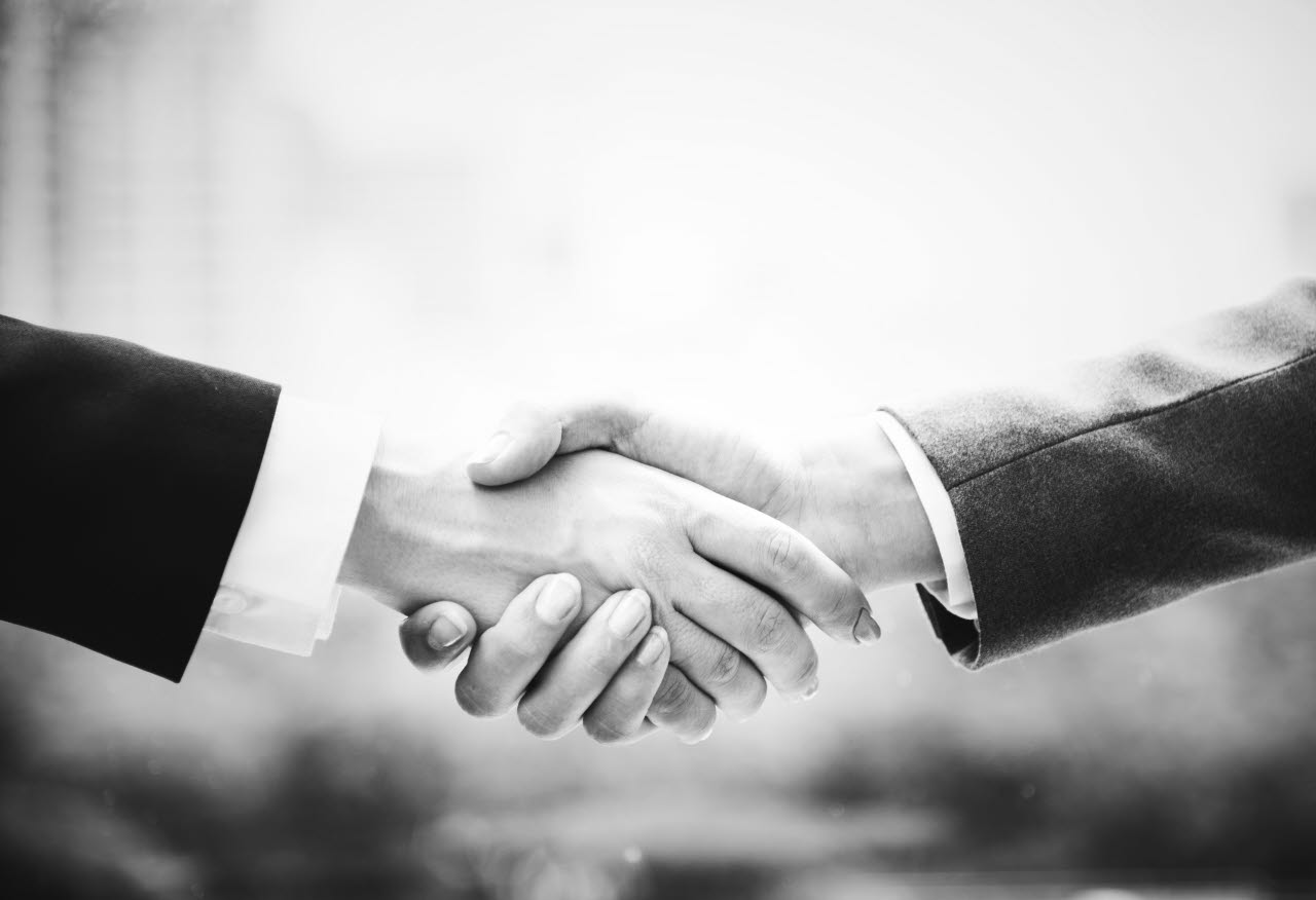 Black and white business deal