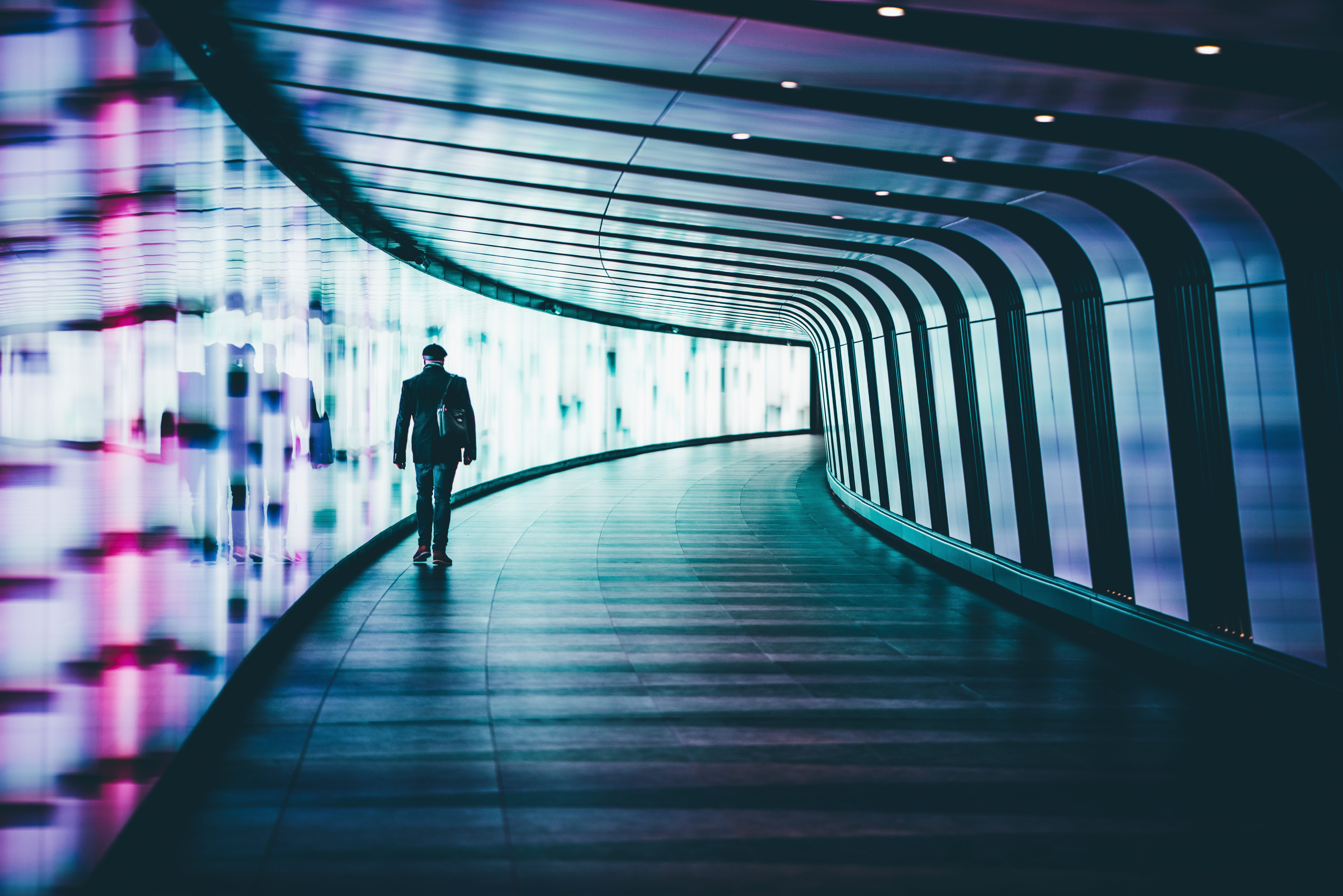 Man-walking-lights-unsplash