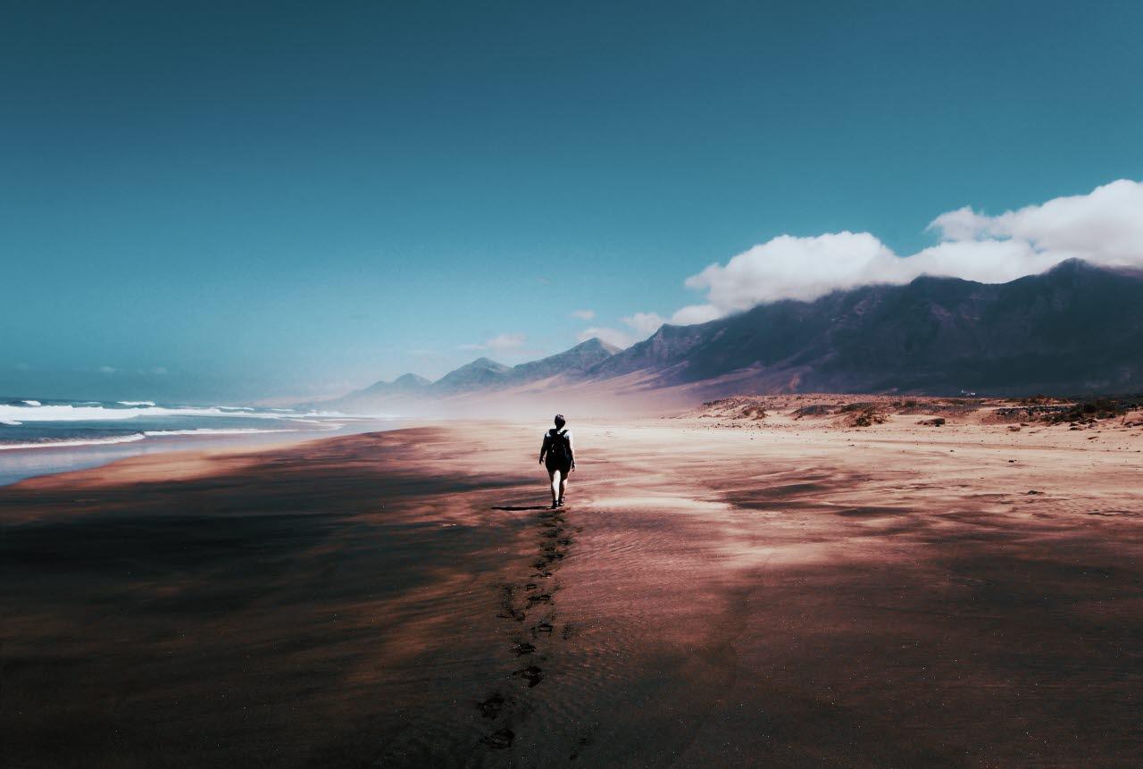 Woman on deserted beach