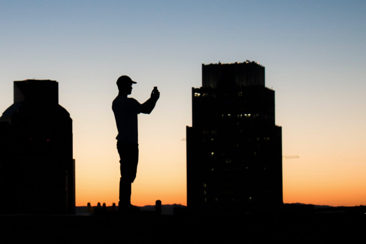Man with camera silhouetted