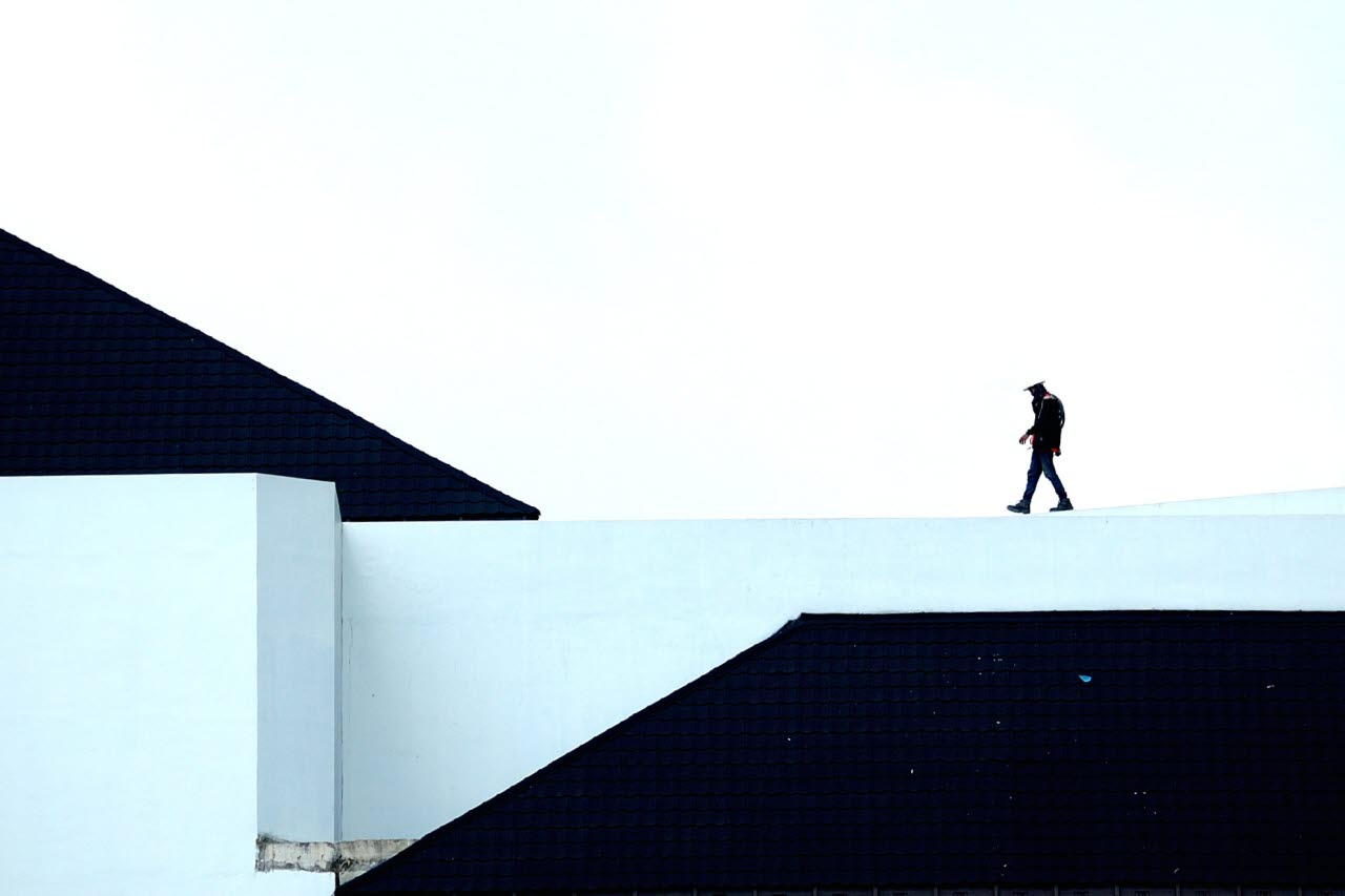 Man walking on rooftop