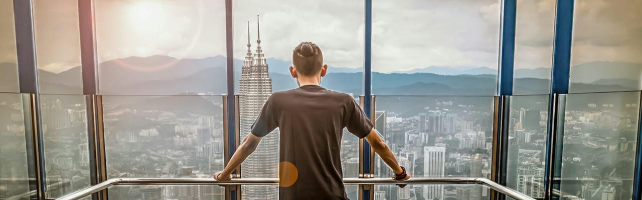 Man with city skyline